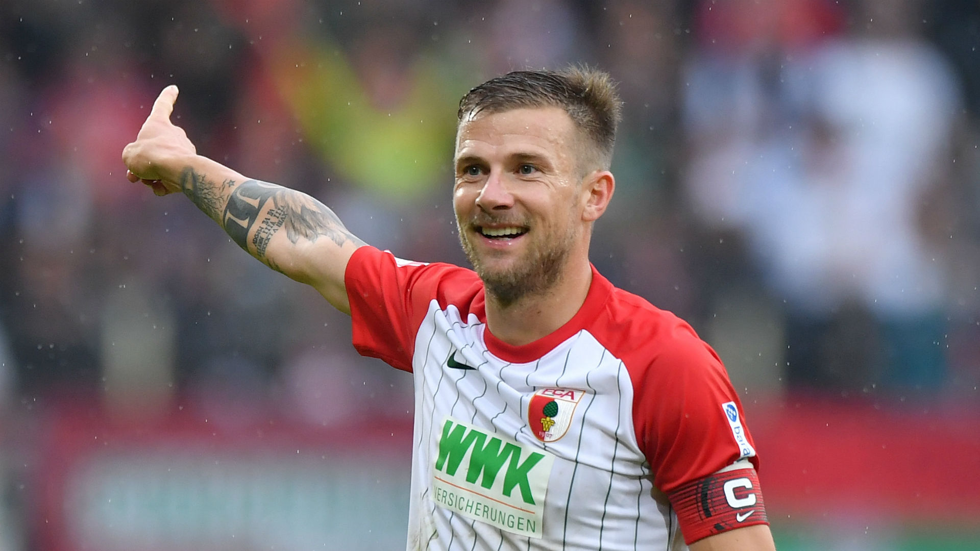 Augsburg captain Baier called to explain obscene gesture