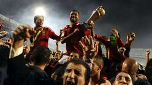 Hossam Ashour of Al-Ahly holds the trophy (2014)