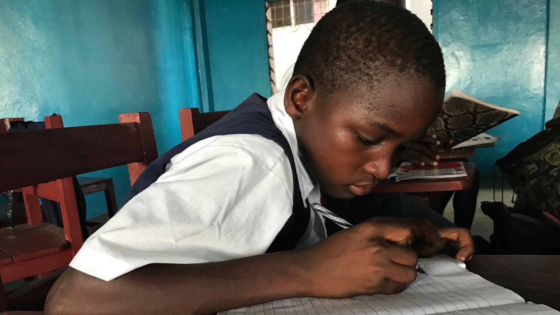 Moses taking notes at Monrovia FA
