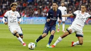 Angel Di Maria (C) of Paris Saint-Germain in action against Montpellier players Keagan Dolly (L) and Ellyes Skhiri (R