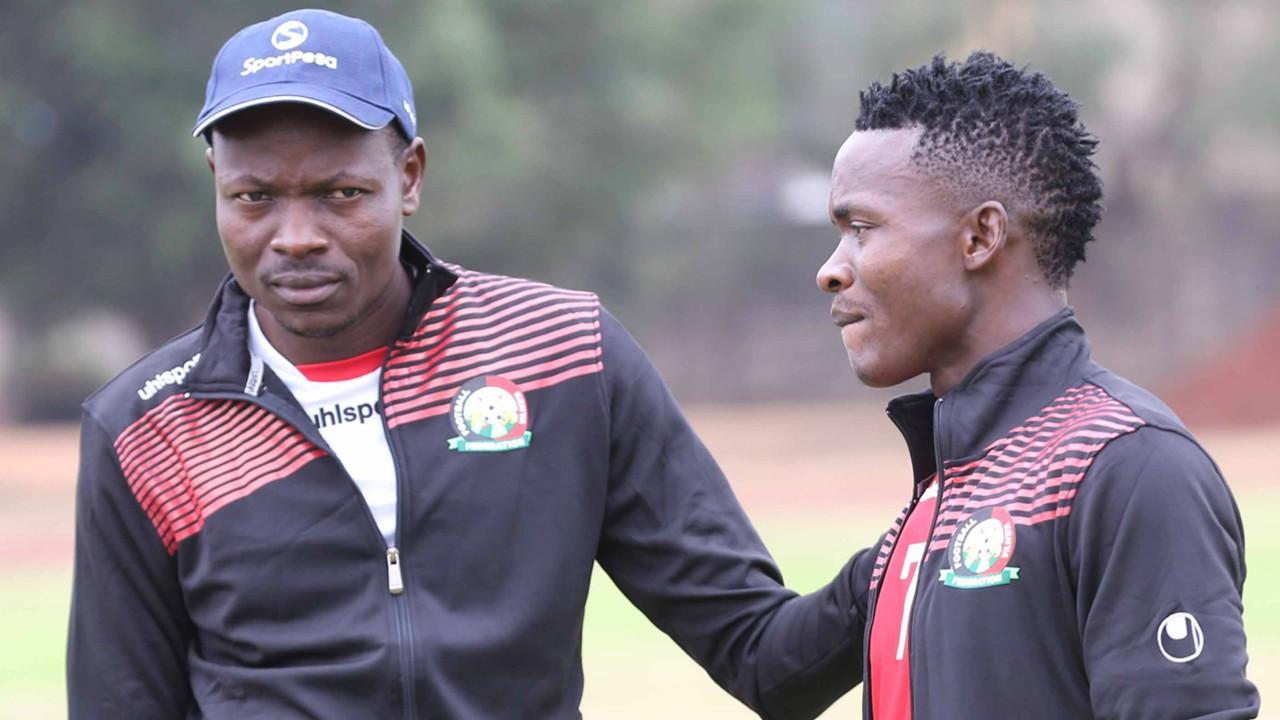 Harambee Stars coach Stanley Okumbi with George Odhiambo of Gor Mahia.