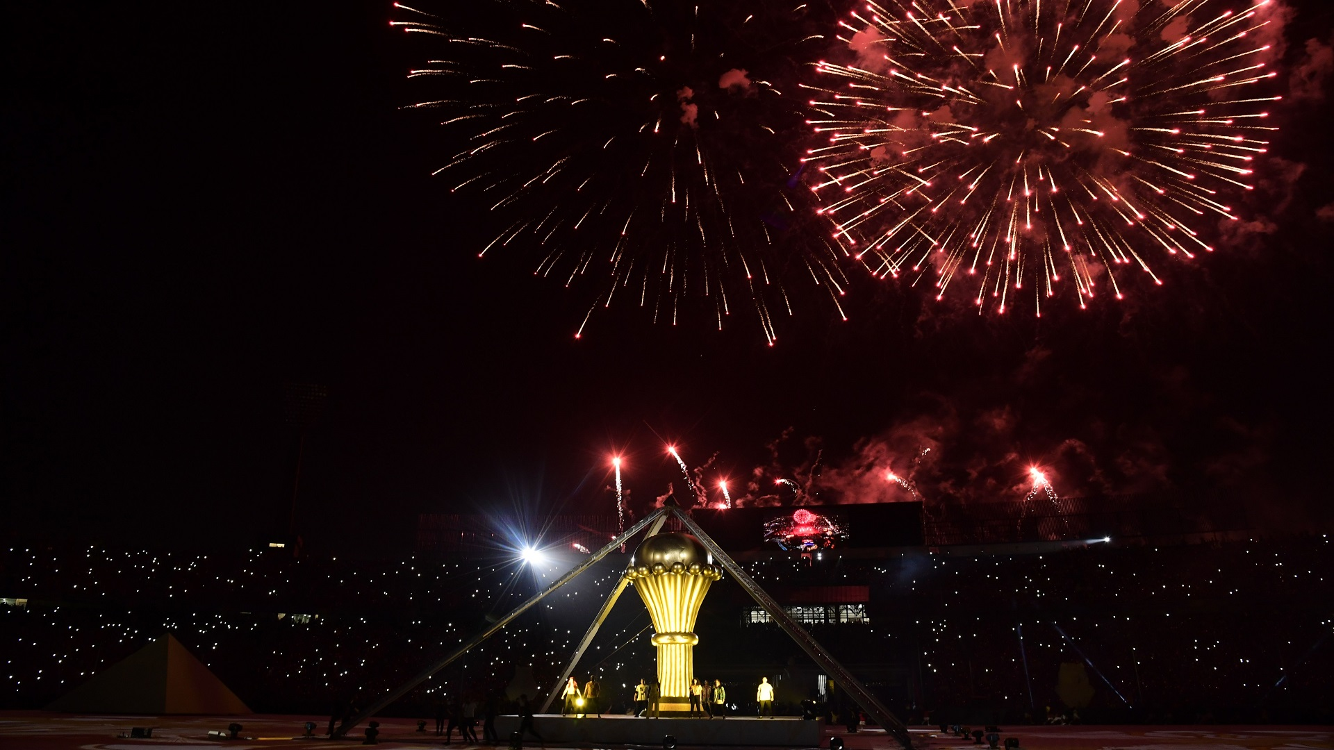 Firework explodes in the sky as performers take part in the opening ceremony of the 2019 Africa Cup of Nations