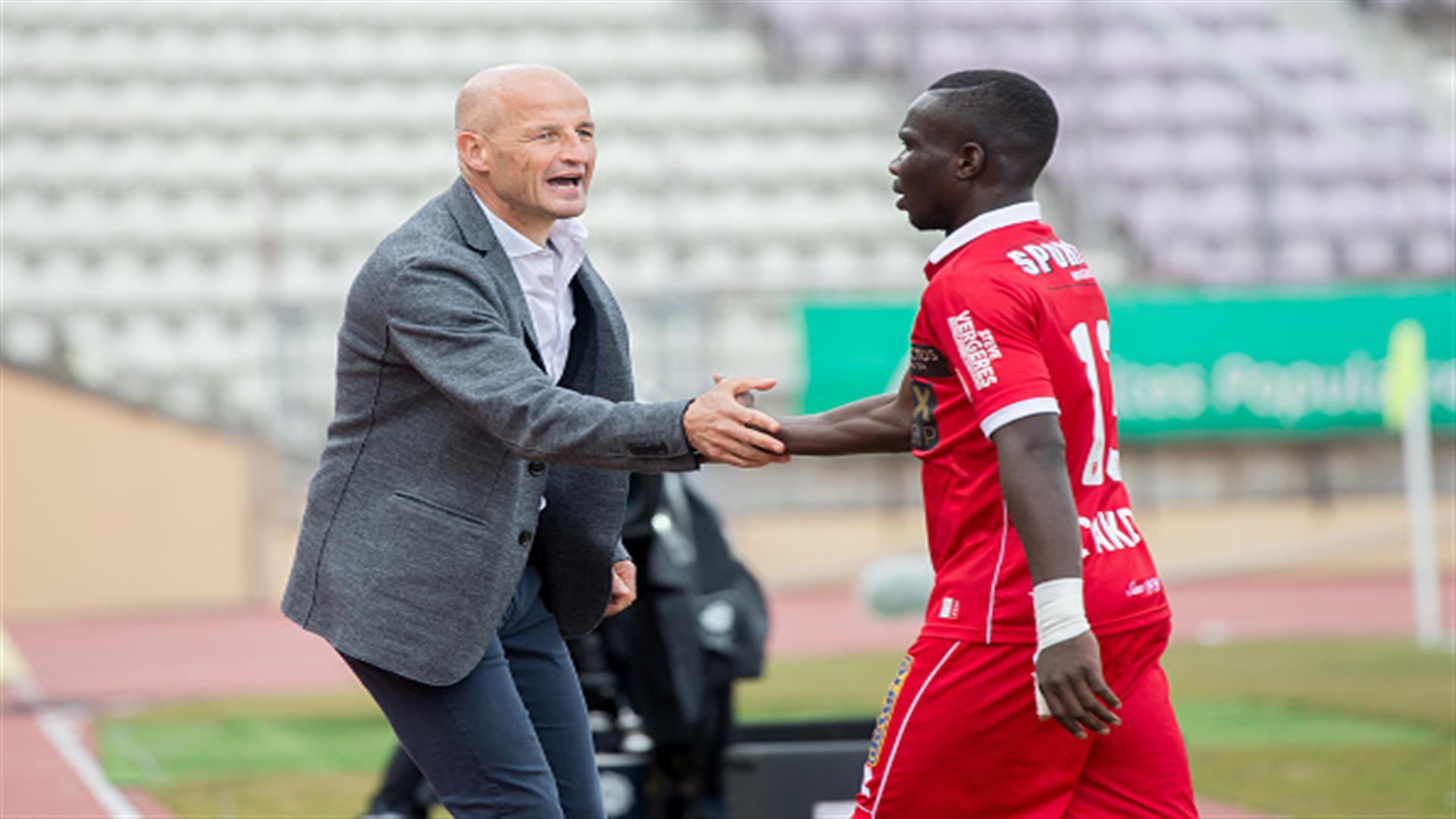 Sebastien Fournier and Chadrac Akolo of FC Sion