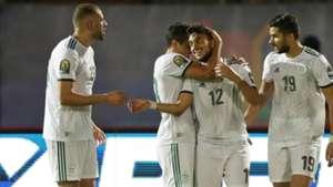 Adam Ounas of Algeria (C) celebrates goal with teammates