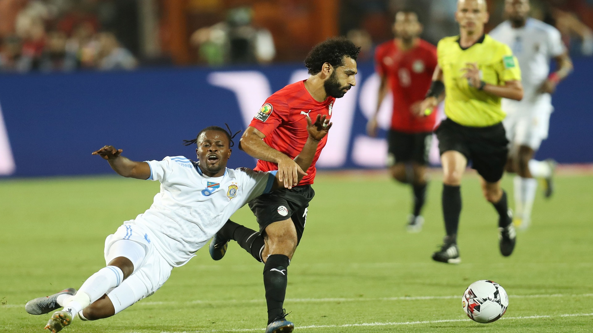 Tresor Mputu of DR Congo is challenged by Mohamed Salah of Egypt Africa Cup of Nations 2019