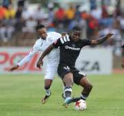 Ntsikelelo Nyauza of Orlando Pirates is challenged by Sinethemba Jantjie of Free State Stars
