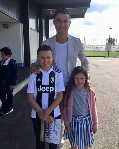 Cristiano Ronaldo with young fan