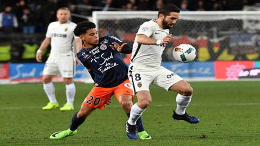 Keagan Dolly of Montpellier with Monaco's Joao Moutinho
