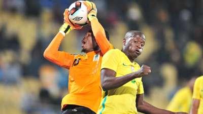 Aishi Manula of Tanzania challenged by Judas Moseamedi of South Africa.