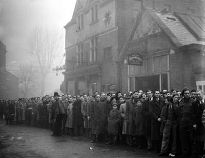 Fans queue outside White Hart Lane in 1945