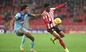 Josh Maja of Sunderland is challenged by Sido Jombati of Wycombe Wanderers