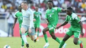 Wayne Rooney challenge Godfrey Walusimbi (L) Kenneth Muguna and Ernest Wendoo
