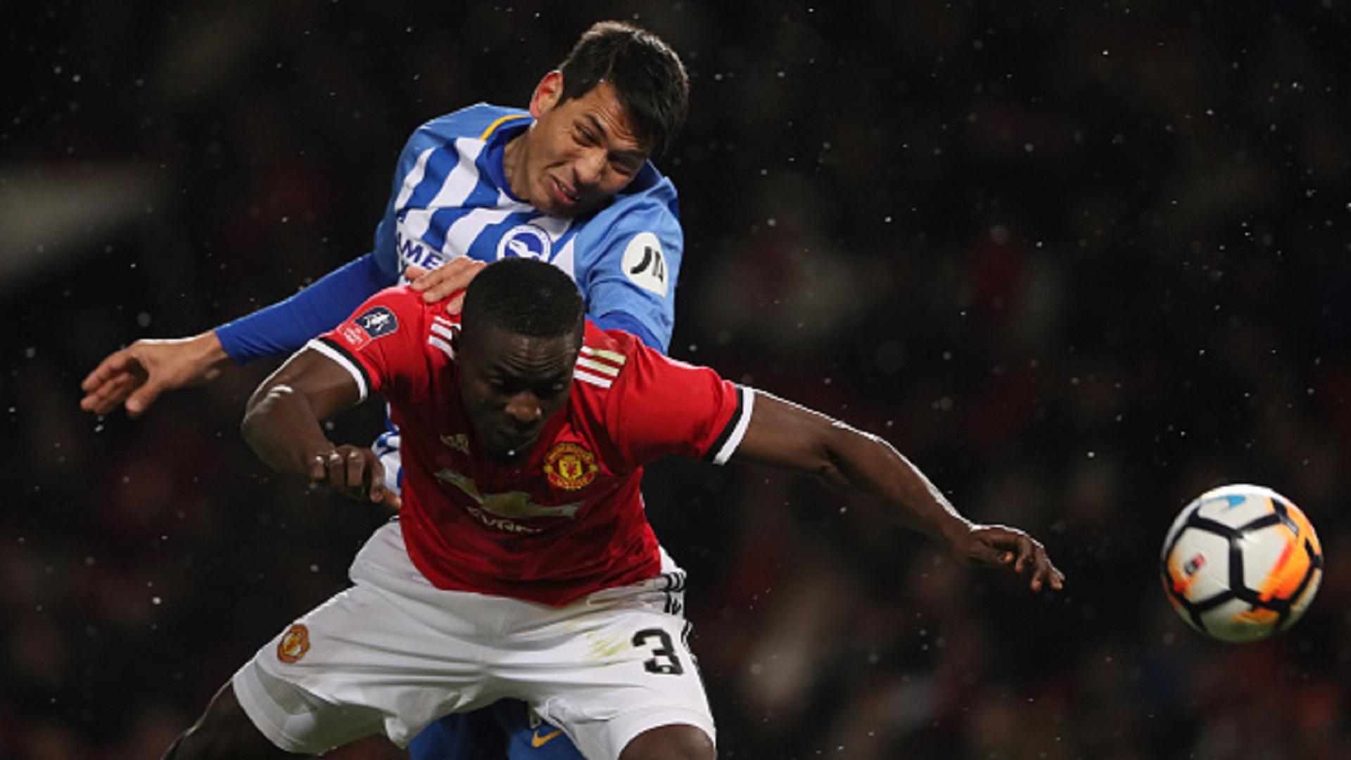 Leonardo Ulloa of Brighton & Hove Albion and Eric Bailly of Manchester United