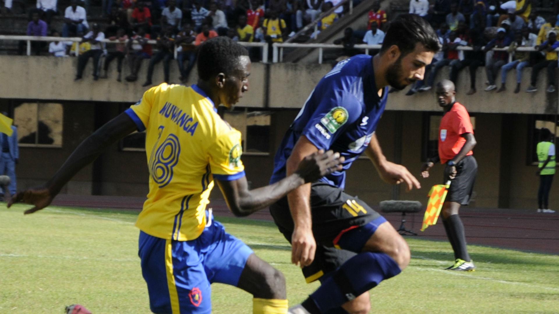 Haythem Jouini (R) of Esperance Sportive de Tunis (EST) and Bernard Muwanga (L) of Kampala Capital City Authority FC (KCCA), July 2018