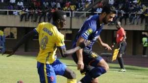 Haythem Jouini (R) of Esperance Sportive de Tunis (EST) and Bernard Muwanga (L) of Kampala Capital City Authority FC (KCCA), July 2018
