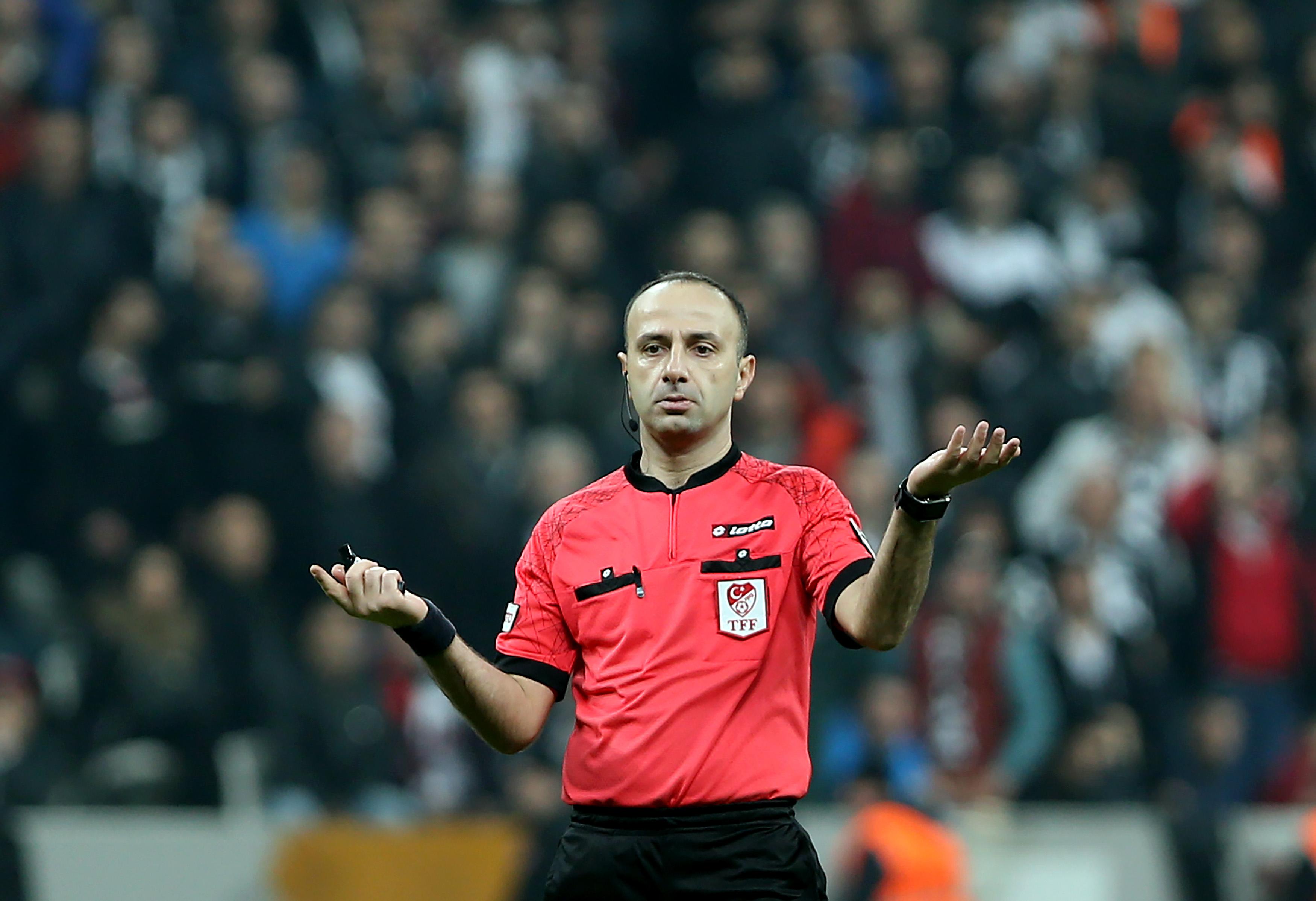 Turkish referee Baris Simsek