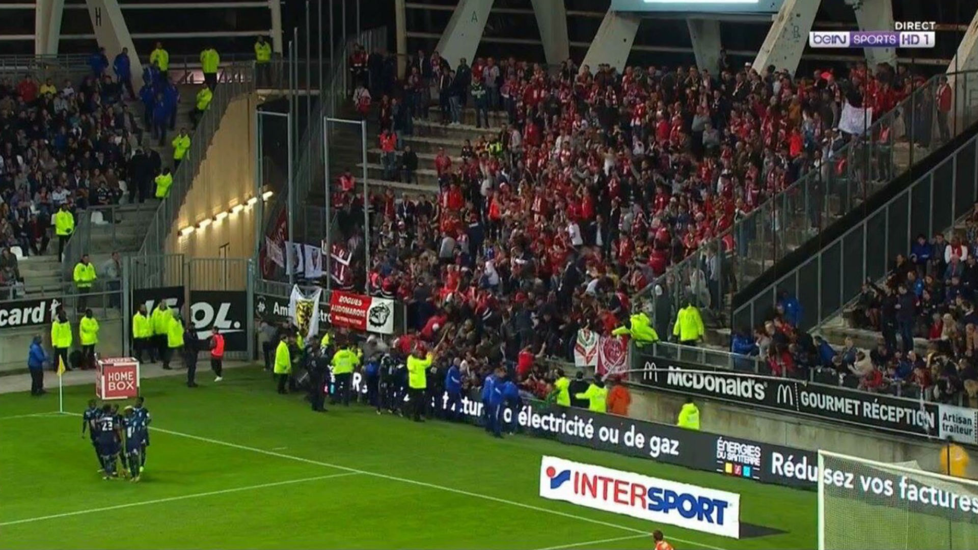 Fans taking pictures with cell phone behind barrier stock photo - Amiens Lille Ligue 1 30092017