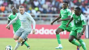 Wayne Rooney challenge Godfrey Walusimbi (L) Kenneth Muguna and Ernest Wendo