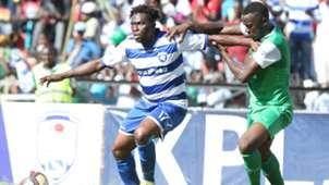 Gor Mahia defender Haroun Shakava v Gilbert Fiamenyo of AFC Leopards.