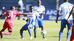 Goefrey Likonoh of Posta Rangers v Vincent Oburu of AFC Leopards.
