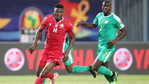 Michael Olunga of Kenya is challenged by Kalidou Koulibaly of Senegal.
