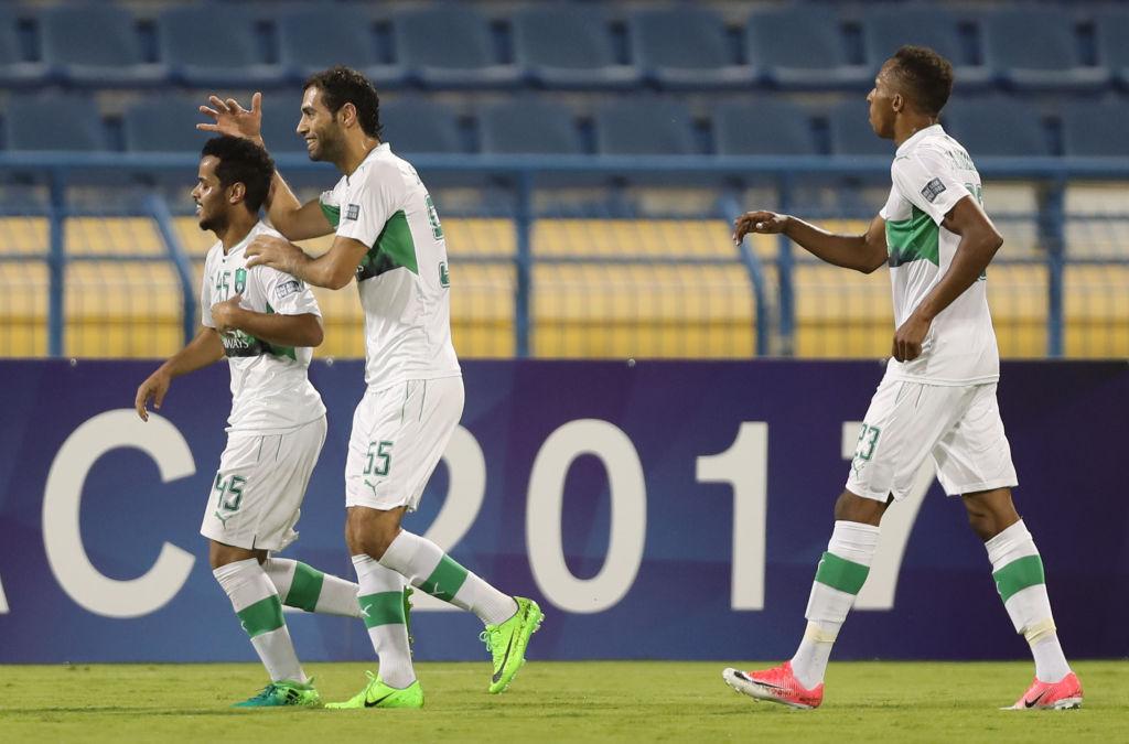 Al Ahli celebrate after defeating Zob Ahan