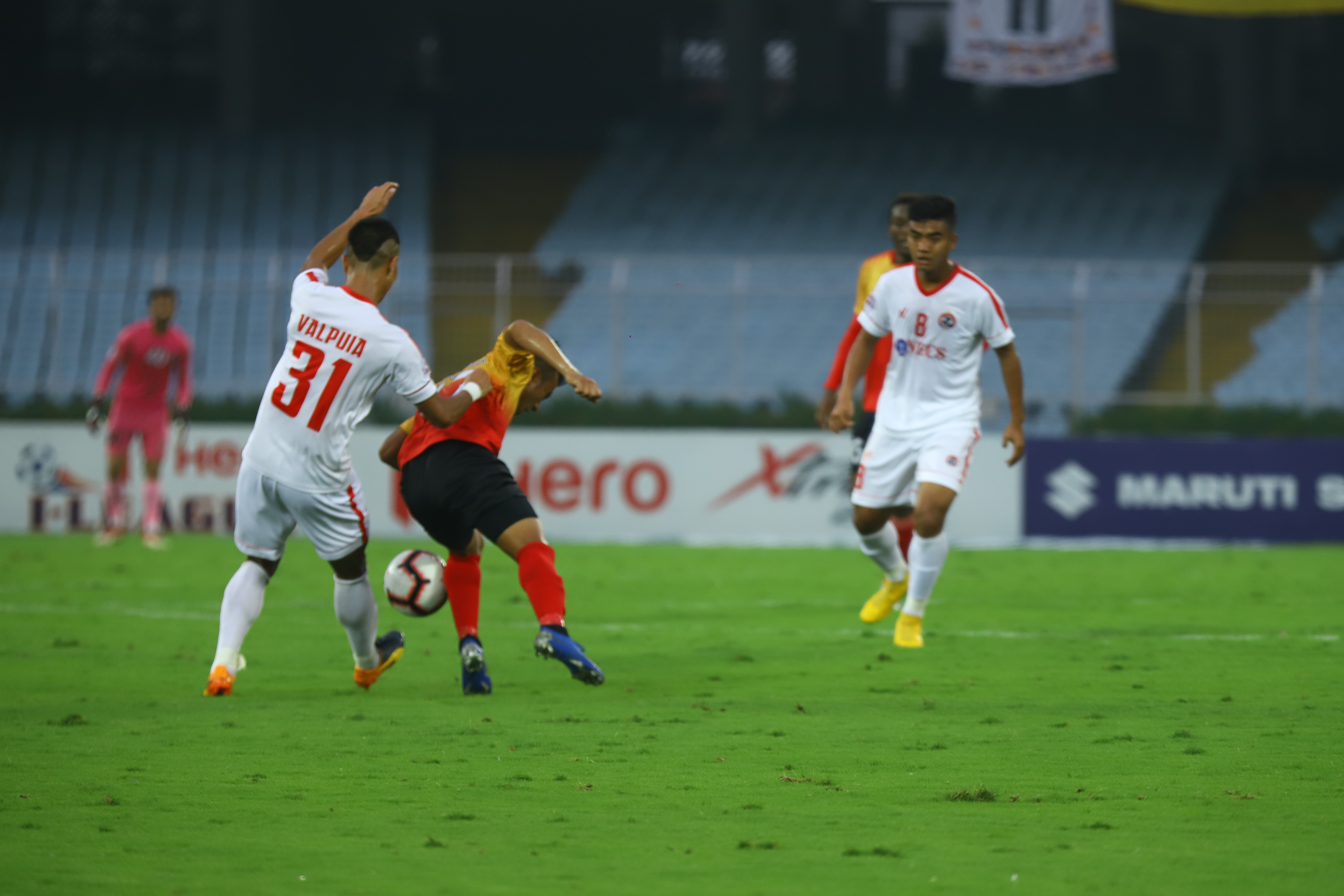 Aizawl FC and East Bengal players tussle for a ball in their I-League encounter (Image Credits- Goal.com)