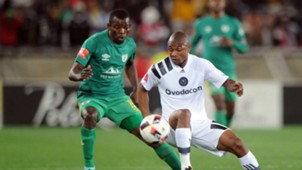 Thabo Qalinge of Orlando Pirates is challenged by Albert Mothupa of Baroka FC