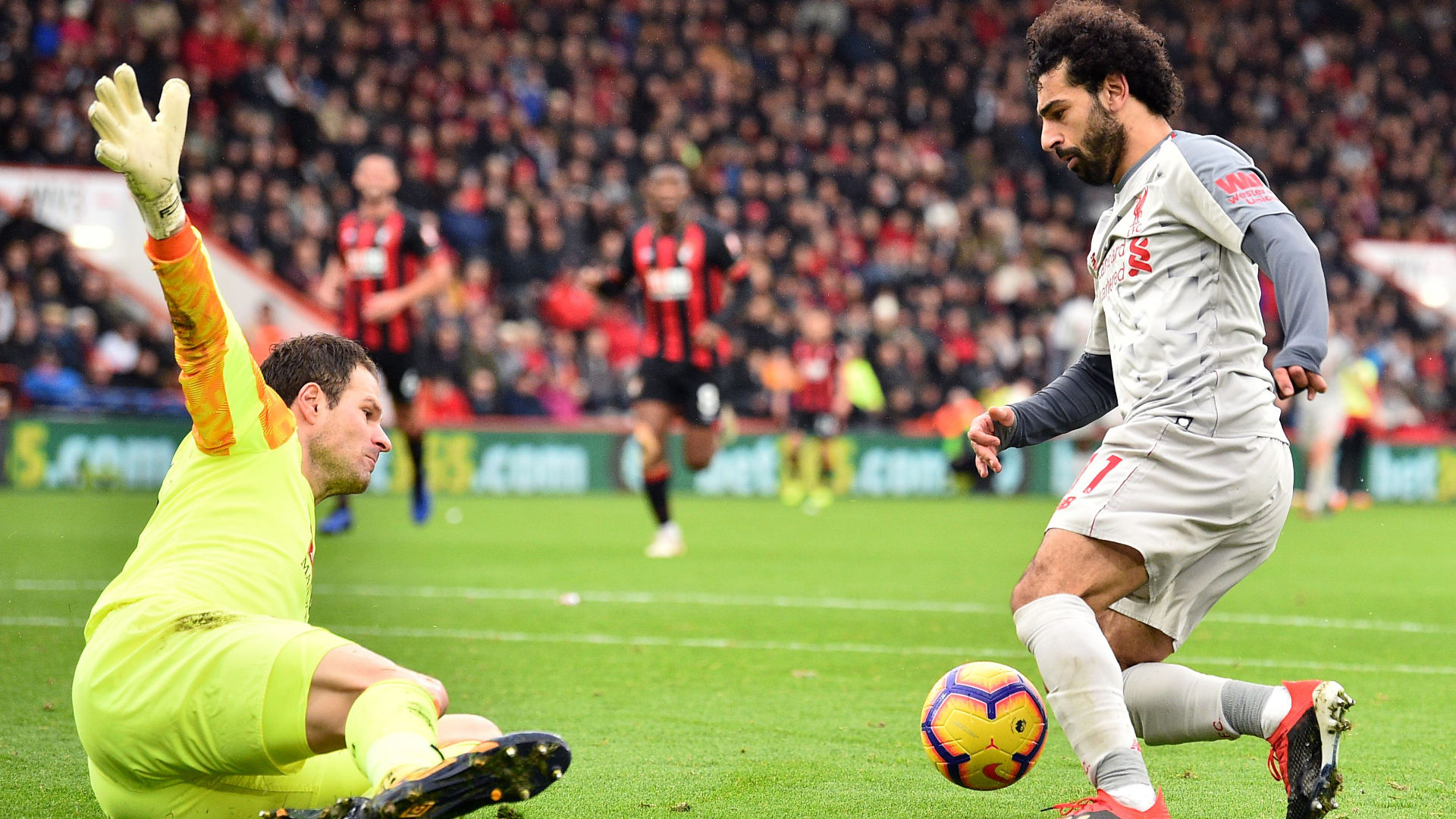 Salah hat trick puts Liverpool top with win at Bournemouth