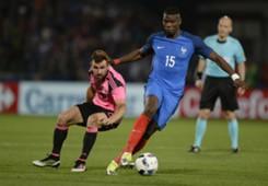 Paul Pogba dribbling for France against Scotland