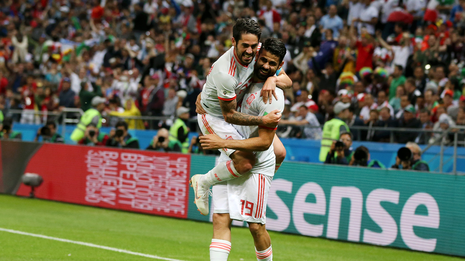 Nervy Spain snatch late 2-2 draw with Morocco to top group
