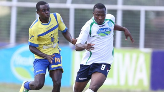 Fredrick Shimonyo of Western Stima tackle Longinus Chibueze of Thika United