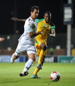 Amr Ahmed Gamal of Bidvest Wits challenged by Albert Mothupa of Baroka FC