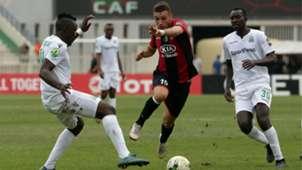 USM Alger player Redouane cherifi (R) and Gor Mahia player Haron Shakava and Humphrey Mieno.