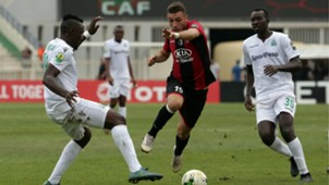 USM Alger player Redouane cherifi (R) and Gor Mahia player Haron Shakava and Humphrey Mieno.