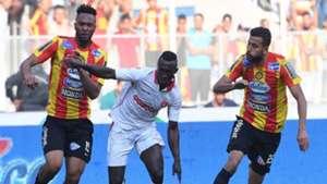 Tunisian Esperance Voussiny Colibaly and Ghailene Chaalali  fight for the ball with Tunisia's Etoile du Sahel Alkhali Bangoura