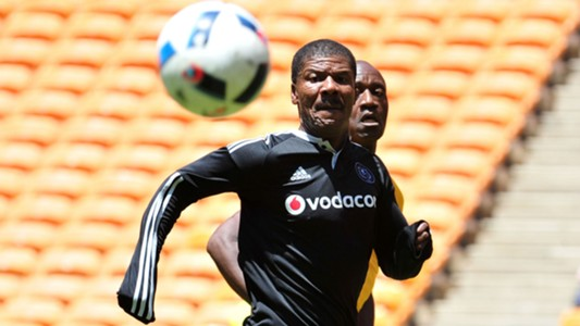 Jerry Sikhosana of Orlando Pirates challenged by Patrick Mabedi of Kaizer Chiefs