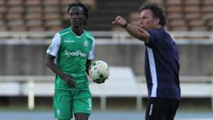 Shafik Batambuze of Gor Mahia and Hassan Oktay.
