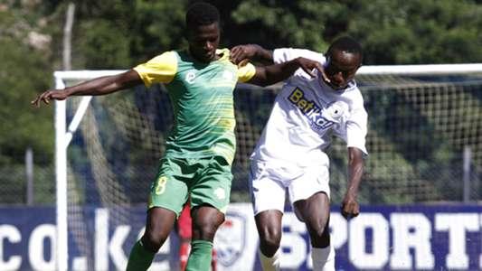 Kariobangi Sharks striker Patillah Omotto takes on James Kasibante of Sofapaka
