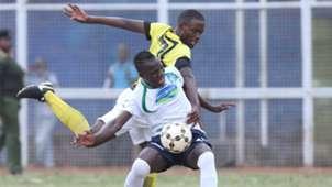 Bernard Mangoli (L) fouls Wilson Amukaya