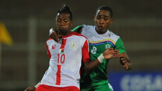 Faouz Attoumane of Comoros tackles Adriamirado Dax of Madagascar, May 2018