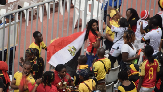 Uganda fans with Egypt flag