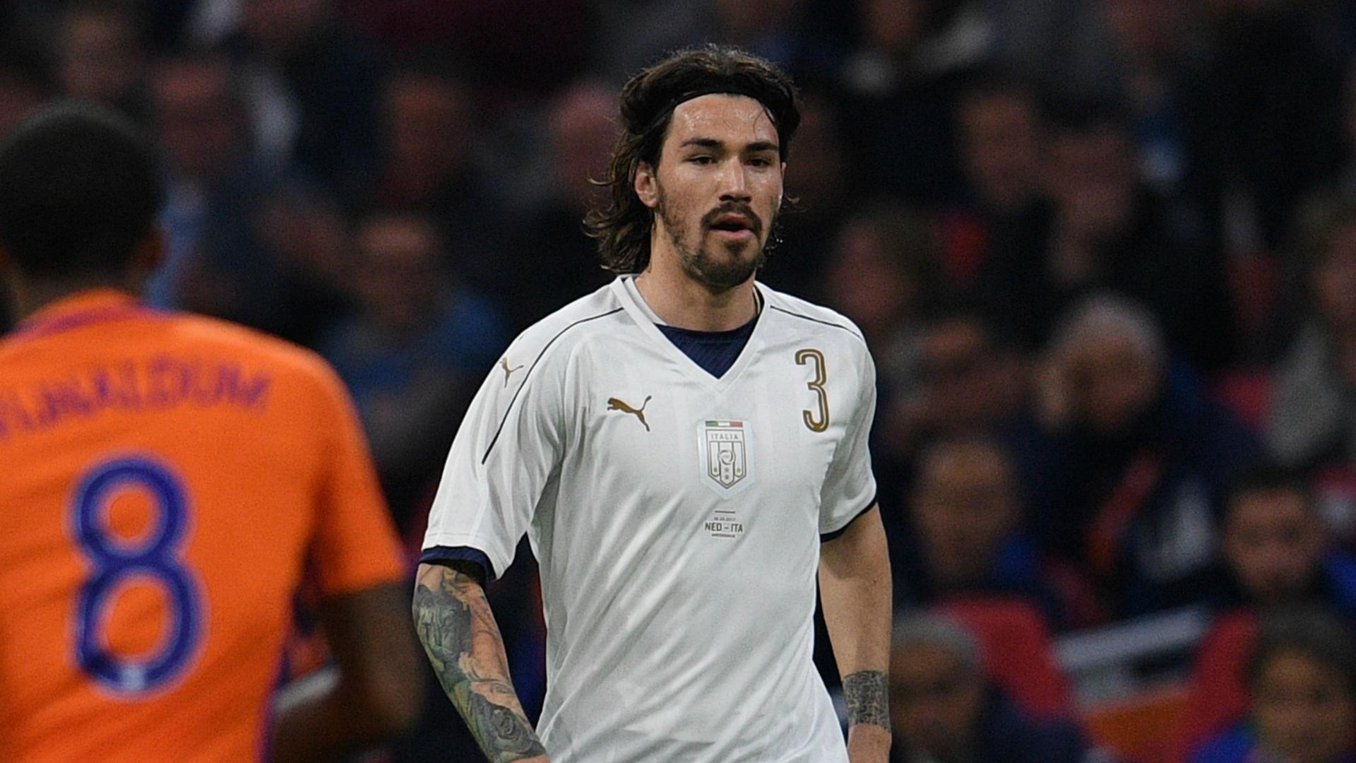 Alessio Romagnoli with Italy shirt