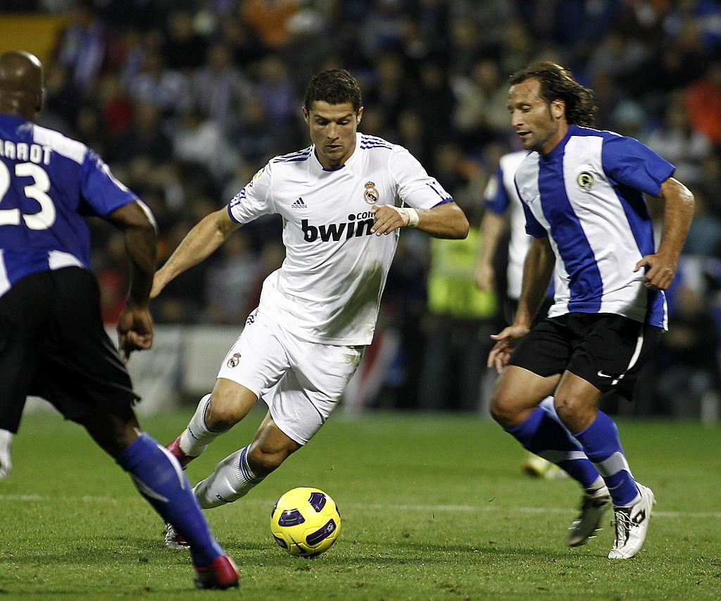 Rufete up against Cristiano Ronaldo