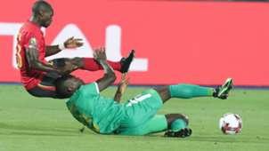 Senegal's Kalidou Koulibaly (bottom) in action Uganda's Michael Azira (L).