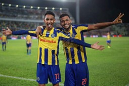 Pahang's Ahmad Syamim Yahya (left) and Matheus Alves Leandro celebrating their goal against T-Team 27/1/2017