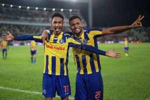 Pahang's Ahmad Syamim Yahya (left) and Matheus Alves Leandro celebrating their goal against T-Team 27/1/2017