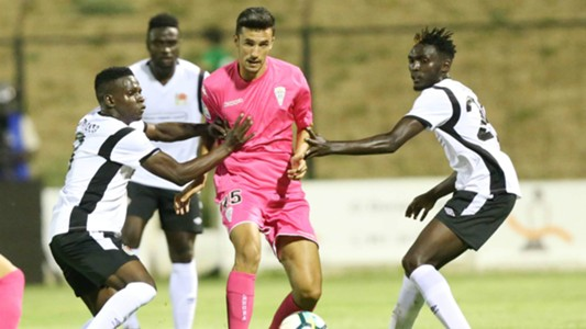 Joel Omotto (L) and Wesley Onguso ® tackle Alberto Quiles of Cordoba