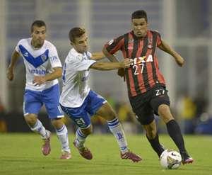 Atletico Paranaense midfielder Matias Mirabaje (R) vies for the ball