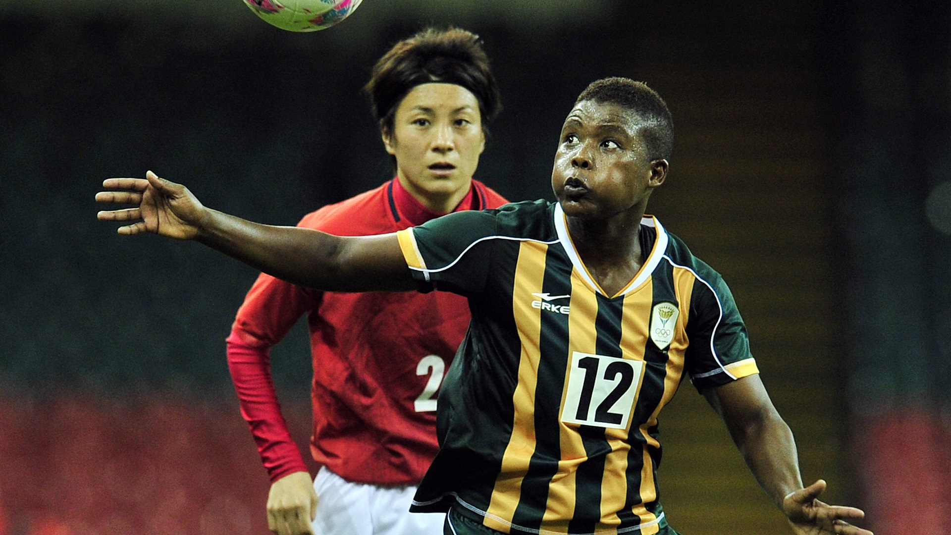South Africa's Portia Modise and Yukari Kinga of Japan